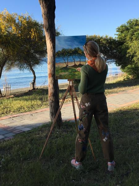 Diana Malivani at work, «en plein air», by the sea (Cyprus)