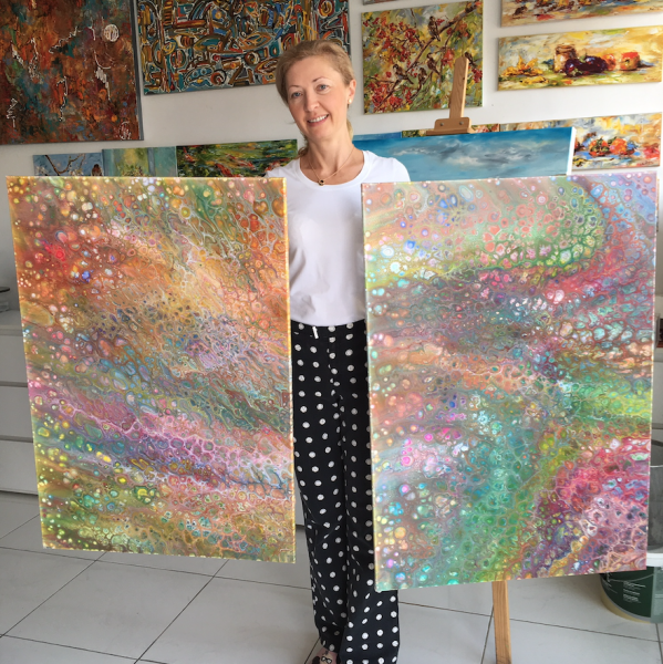 Diana Malivani in her Artist's Studio in Cyprus, with acrylic poured canvases, ready for painting
